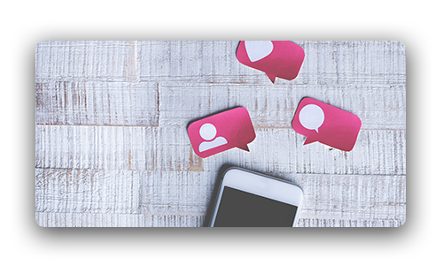 cell phone with pink speech bubbles