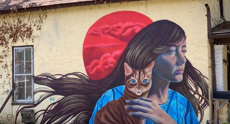 Street art mural with a women and cat